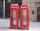 Picture representing tell a friend - pair of telephone boxes